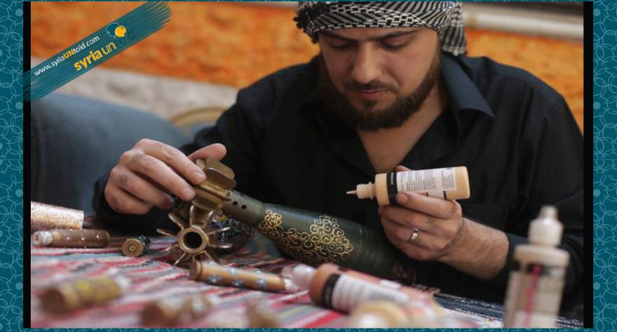 Syrian artist Ali Abu al-Fawz decorates a rocket shell in Douma, Damascus. Source: Abu al-Fawz's facebook page.