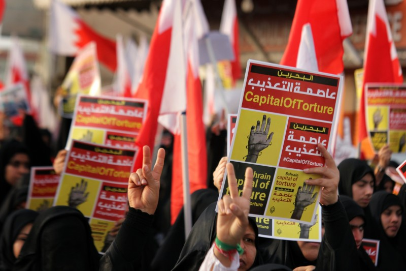 "A poster at an opposition rally in Bahrain in May 2013 describes the country as ""Capital of torture.""  Photo by Ammar Bin Yasser. Copyright Demotix"
