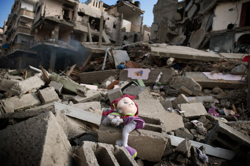 A doll lies on the rubble of a destroyed building on July 11, 2014, following an Israeli airstrike in Gaza City. Photo by Marco Bottelli. Copyright Demotix.