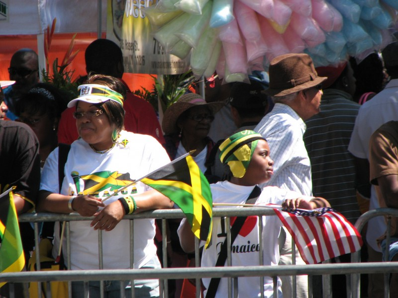 A Jamaican and an American flag on display at the 2008 West Indian-American Carnival in Brooklyn, NY. Photo by David Berkowitz, used under an CC license.