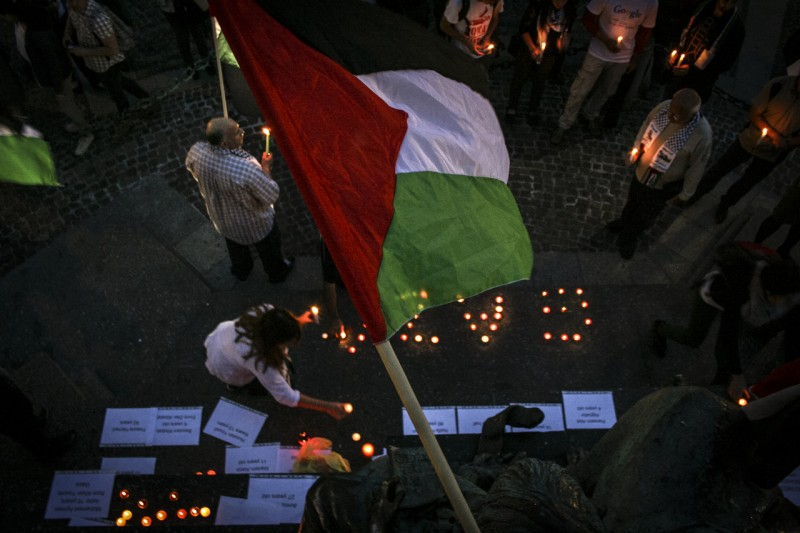 """On July 12th a group of people organised a silent protest in Krakow – in solidarity with Gaza. Protesters printed names of all the children martyred in Gaza during operation ""Protective Edge""."""