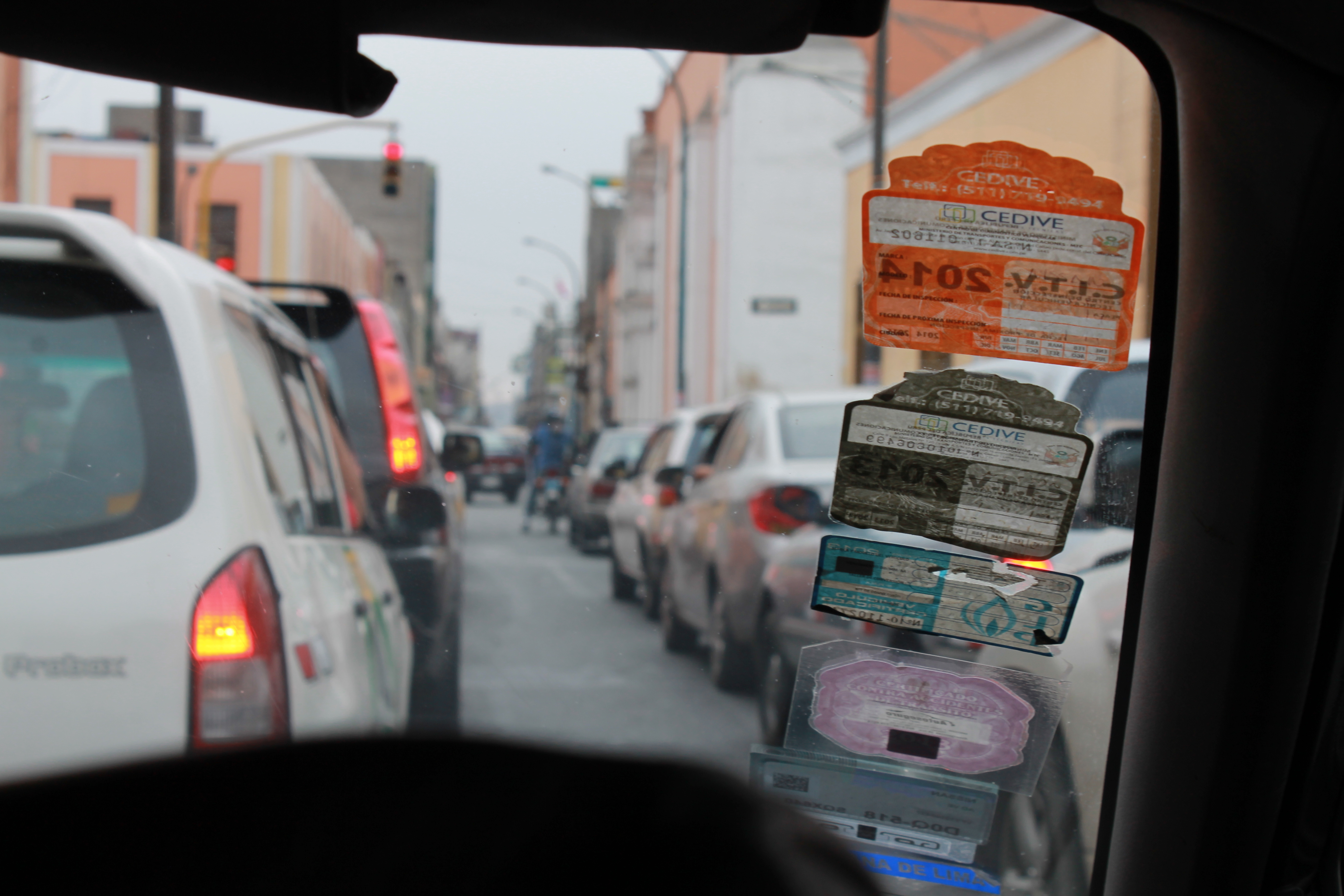 A taxi driver's accumulated yearly permits displayed on his windscreen. Photo by Alex Pashley.