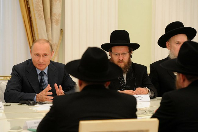 Vladimir Putin meets with religious officials, July 9, 2014, Moscow, Russia. Kremlin Press Service, Public domain.