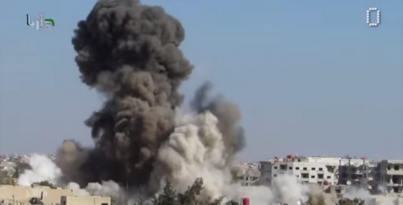 A screenshot of a YouTube video by  SyrianZero reportedly showing barrel bombs dropped by the Assad regime.