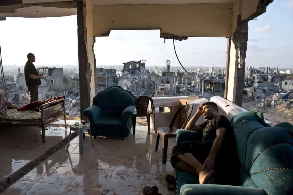 "This image, simply entitled ""Seen in Gaza"" shows two Palestinian men in Gaza overlooking their destroyed city which was destroyed by an Israeli attack"
