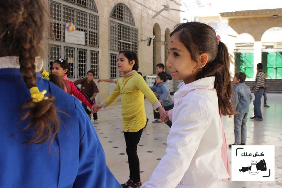 Girls play during one of the Kesh Malek projects in Aleppo, Syria. Source: Kesh Malek's website