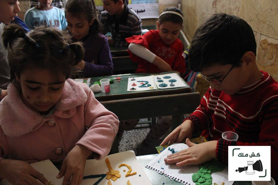 Children during of the Kesh Malek projects in Aleppo, Syria. Source: Kesh Malek's website.