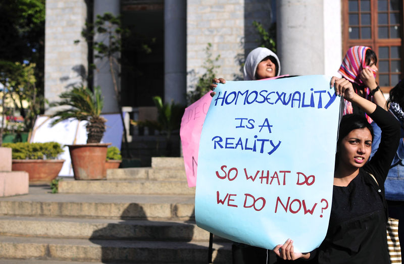 An Indian gay rights activist holds a placard denouncing a Supreme Court ruling criminalising gay sex in Bangalore, India. Image by Abhishek Chinnappa. Copyright Demotix (11/12/2013)