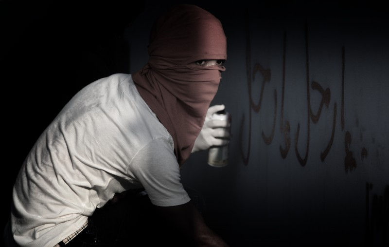 Bahraini protester sprays anti-government graffiti. Photo by Eman Redha. Copyright: Demotix