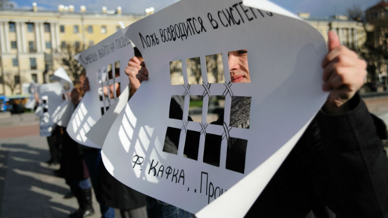 Participants of the picket in support of Bolotnaya Square prisoners in St. Petersburg hold banners in the form of prison bars. Photo by Denis Tarasov for Demotix.