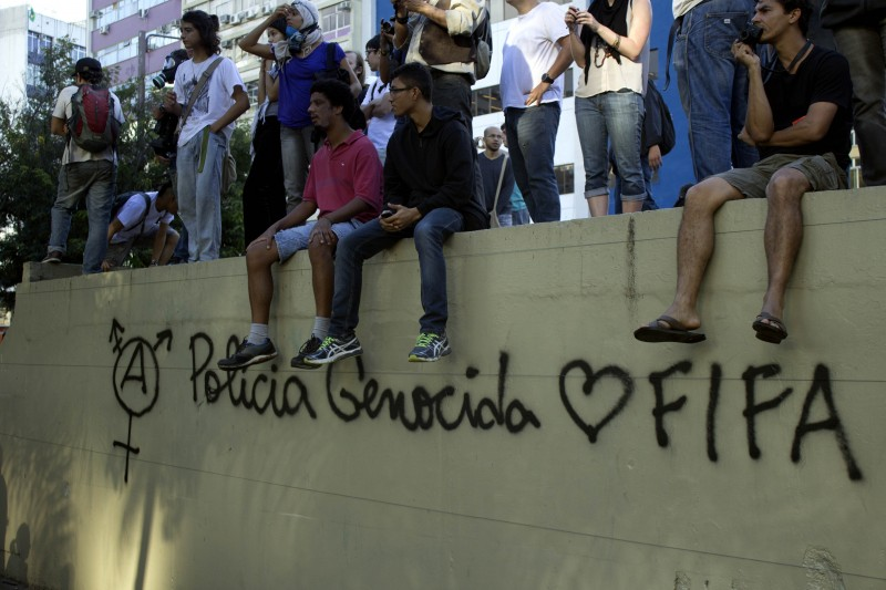 "Graffiti on the walls in Barra da Tijuca in Rio de Janeiro reads, ""Genocidal police loves FIFA."" 13 July 2014. Photo by Shay Horse. Copyright Demotix"