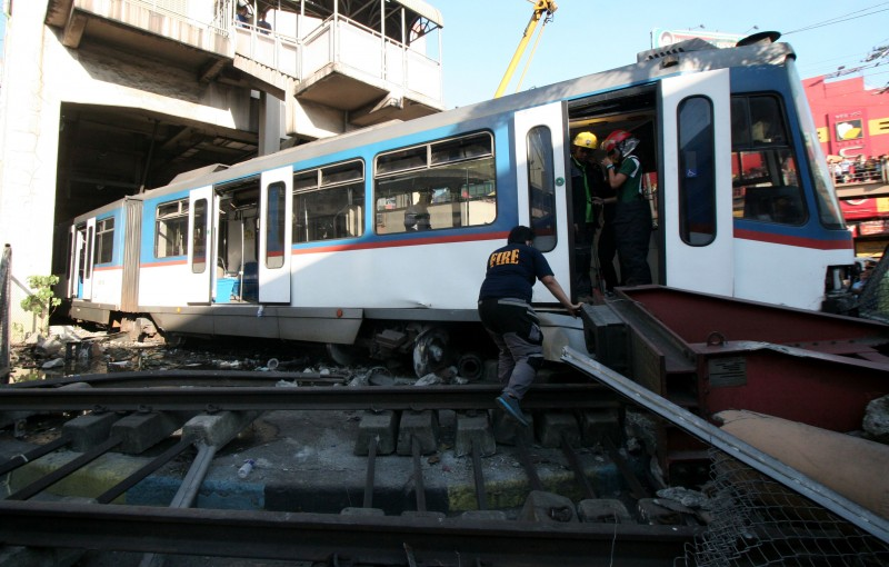 A train overshot it's stop at a terminal in Manila. Photo by Juan Carlo de Vela. Copyright @Demotix. (8/13/2014)