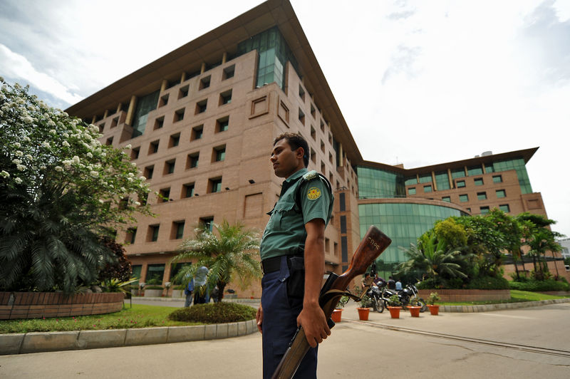 A police guards in front of the United Hospital in Dhaka. Image by Firoz Ahmed. Copyright Demotix
