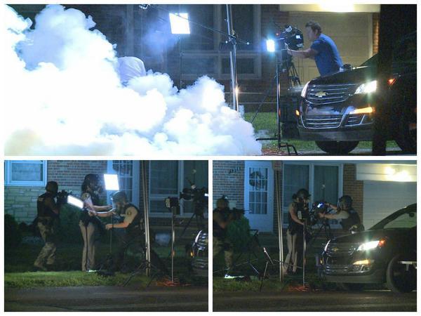 "Photos tweeted by Missouri based journalist @CassFM ""Police fire tear gas near Al Jazeera crew, then disassemble the gear after they flee. #Ferguson"""