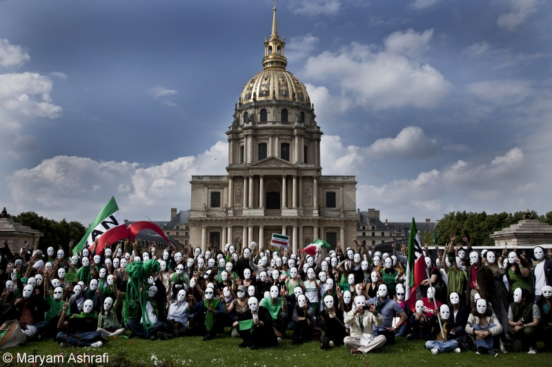 Iranians gather in Paris on June 12, 2010 to mark the first anniversary of the Green Movement, on the day the government was accused of rigging the 2009 Presidential elections.