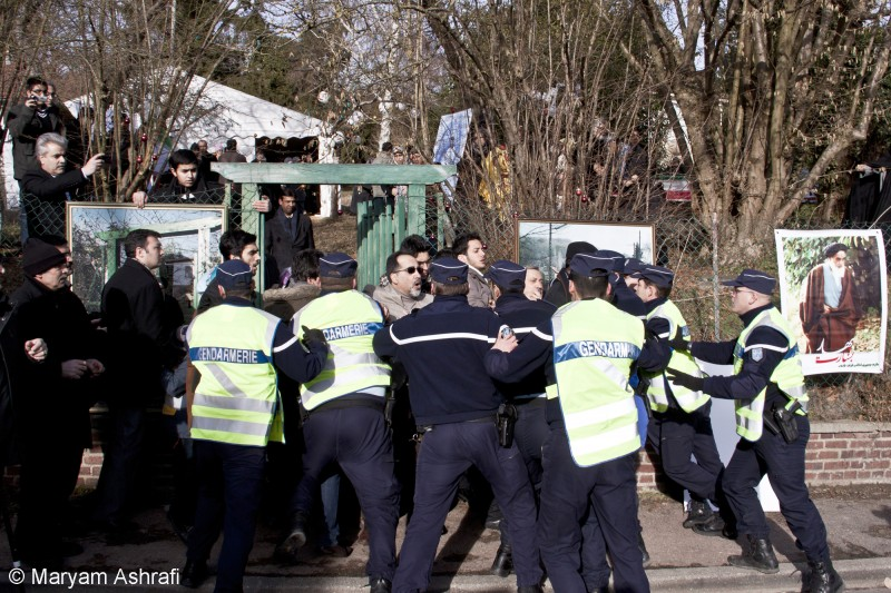 The Iranian ambassador in France Mehdi Mir Abu Talebi and his entourage as they are restrained by the French police at Neauphle-le-Chateau, on the outskirts of Paris, where the Ayatollah used to reside. The ambassador tried to confront the protesters on the day to commemorate the founder of the Islamic Revolution Ayatollah Khomeini's return to France on January 31, 1979.