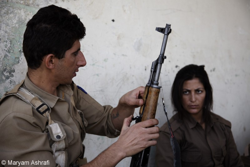 Maryam captured Kurdish peshmergas learning to use their guns inside the military training camp of the Komala party of Iranian Kurdistan in late 2012. Sulaymaniyah, Kurdistan.