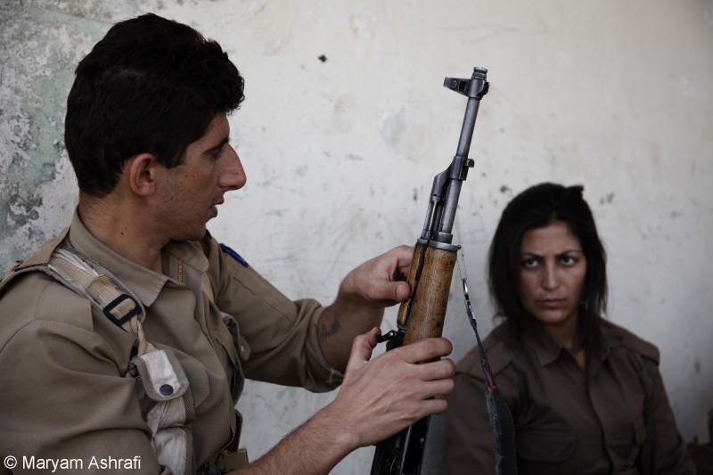 Maryam captured Kurdish peshmergas learning to use their guns inside the military training camp of the Komala party of Iranian Kurdistan in late 2012. Sulaymaniyah, Kurdistan.