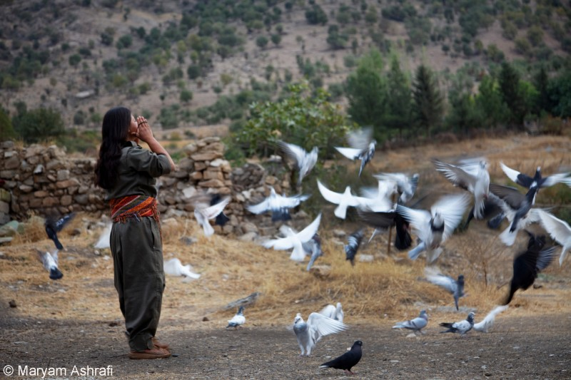 Zilan, a female PJAK guerrilla binds her hair before starting her daily routines inside the camp located in Qandil, Kurdistan in 2012.