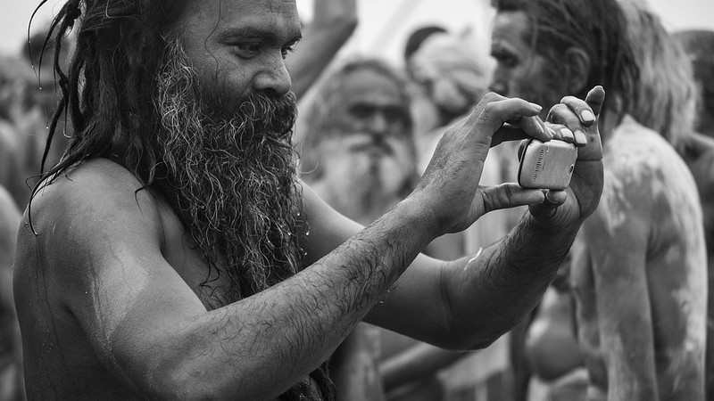 A sadhu in India goes hi-tech with a mobile camera. Image by utilitarian via Flickr. CC BY-NC