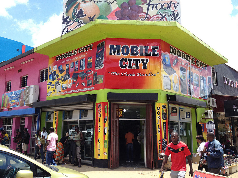Mobile phone shop in Lusaka, Zambia. Photo by Curious Lee via Flickr (CC BY-NC-SA 2.0)