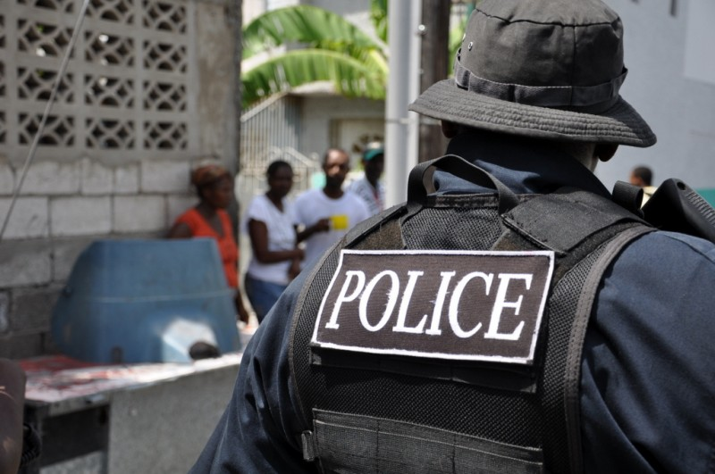Police in Tivoli Gardens, Jamaica, during the 2010 State of Emergency; photo taken from the BBC World Service flickr page, used under a CC BY-NC 2.0 license.