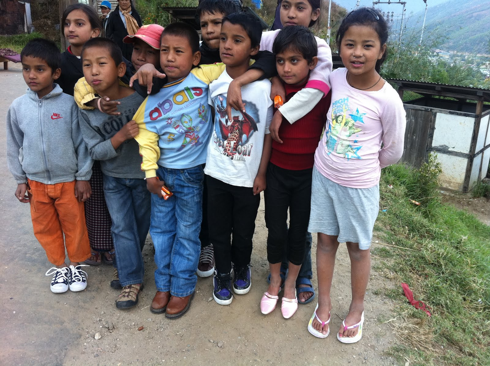 Happy kids with recycled shoes. Image by Help Shoe Bhutan. Used with permission.