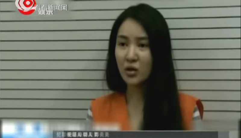 Guo Meimei confessed on CCTV on her crime and decadent lifestyle. She also apologized to Red Cross China for undermining its credibility. Screen capture from Shanghai TV on Youtube.