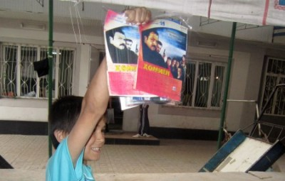 A boy holding dvds, turkish soap