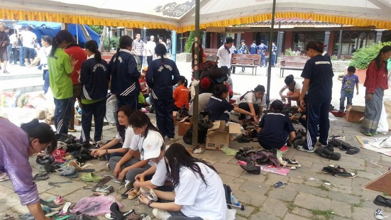olunteers concentrating on how to recycle the shoes collected during the collection drive. These will soon be sent to corners of Bhutan for distribution. 500 pairs equals 500 smiling faces. Image used with permission.