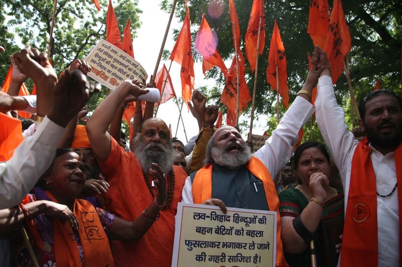 Activists of United Hindu Front raising slogan during a protest against Love jihad in New Delhi, India. Image by Anil Kumar Shakya. Copyright Demotix (23/9/2014)