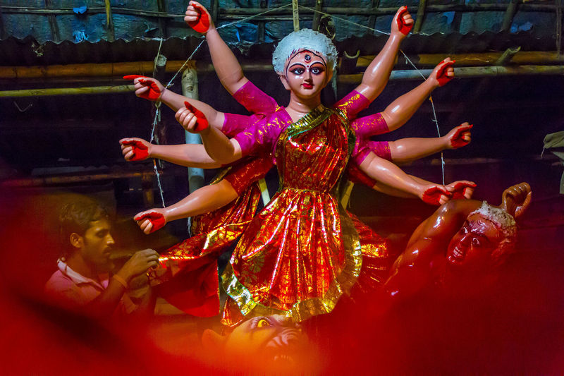 Durga Puja, the annual Hindu festival that involves worship of the Goddess Durga, who symbolizes power and the triumph of good over evil in Hindu mythology. Image by Luit Chaliha. Copyright Demotix (27/9/2014)