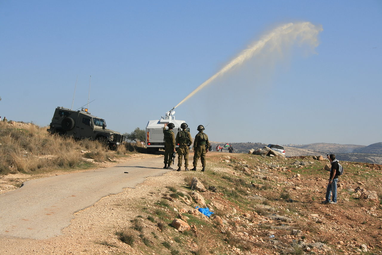 The Skunk liquid being used against Protesters in the Occupied West Bank. (Image by טל קינג, Wikimedia)