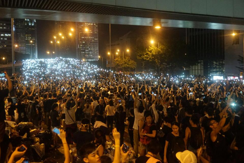 Thousands of protesters light up Admiralty, a business and commercial district in the city center in the evening of September 29.