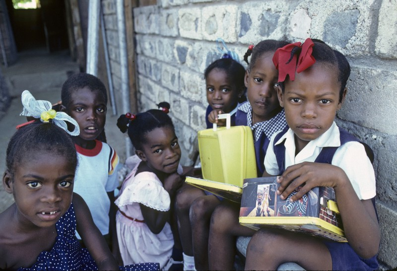 Children at an outdoor class run by the local community for the children of squatters in Kingston, Jamaica; photo by the United Nations, used under a CC BY-NC-ND 2.0 license.