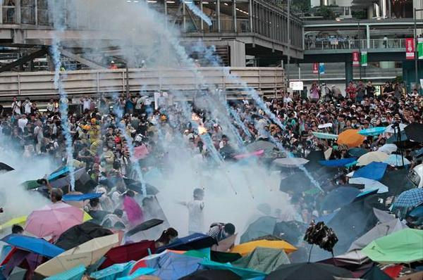 Protesters in Hong Kong are using umbrellas to shield themselves from tear gas.  Photo from Twitter @15MBcn_int