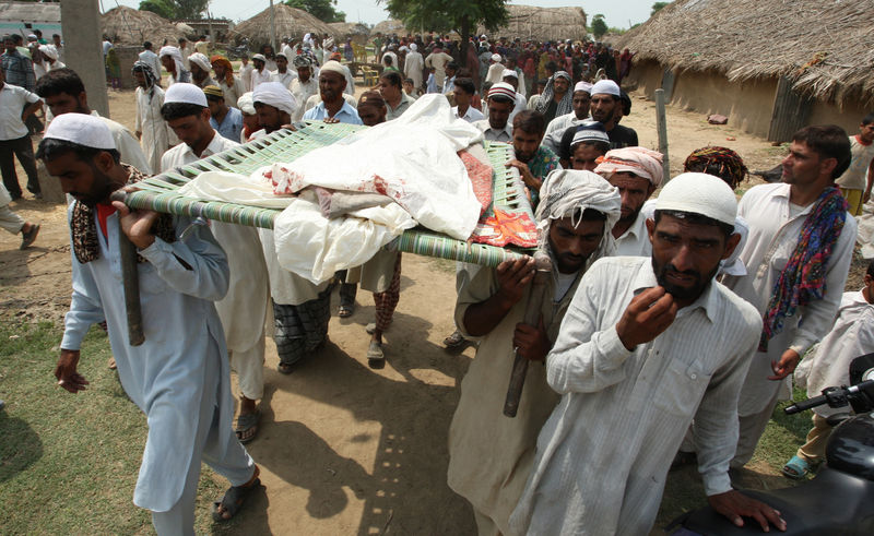 Indian villagers carry the dead bodies of Akram Hussain who was killed in alleged Pakistan mortar firing at Jeora village of R.S Pura border sector about 32 km from Jammu, India. Image by Amarjeet Singh. Copyright Demotix (23/8/2014)
