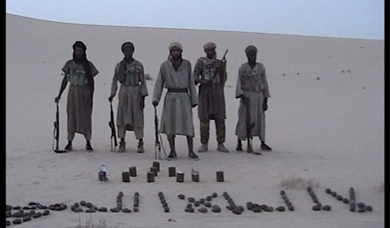 AQIM militants in the Algerian desert via wikimedia commons - Public Domain