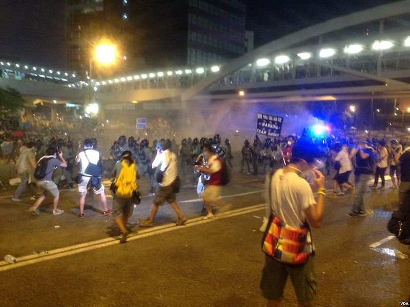 Protesters face tear gas in Hong Kong, Sept. 28, 2014. Photo by 海彥, released to public domain by Voice of America.