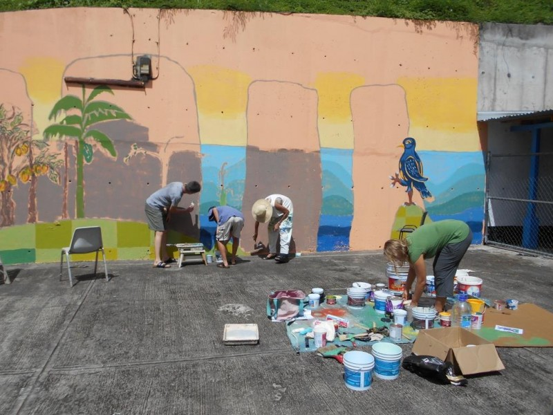 Kai and Anja Niermann and Lene Kilde in process, working on the mural. Photo courtesy the artists; used with permission.