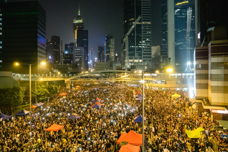 Mobile phones light up the crowd of pro-democracy protesters in Hong Kong on September 30, 2014. Photo by Flickr user Pasu Au Yeung. CC BY 2.0