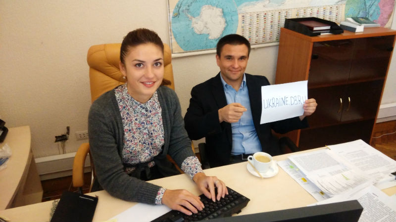 Pavel Klimkin holds up a piece of paper for a proof pic during his online chat. Image from Facebook.
