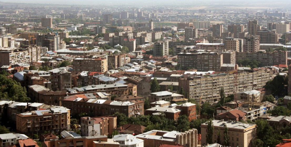Looking south across contemporary Yerevan with a mixture of new construction sites and Soviet social housings.  Image credit: Hachikyan Alina.