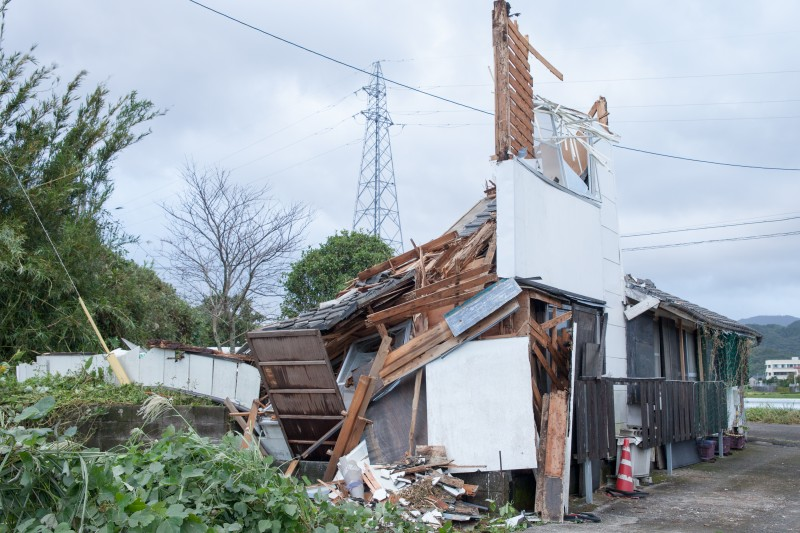 A destroyed house saw its walls and roof on the second floor collapse due to the strong winds in Makurazaki region in Japan. 13 October 2014. Photo by rieko uekama. Copyright Demotix.