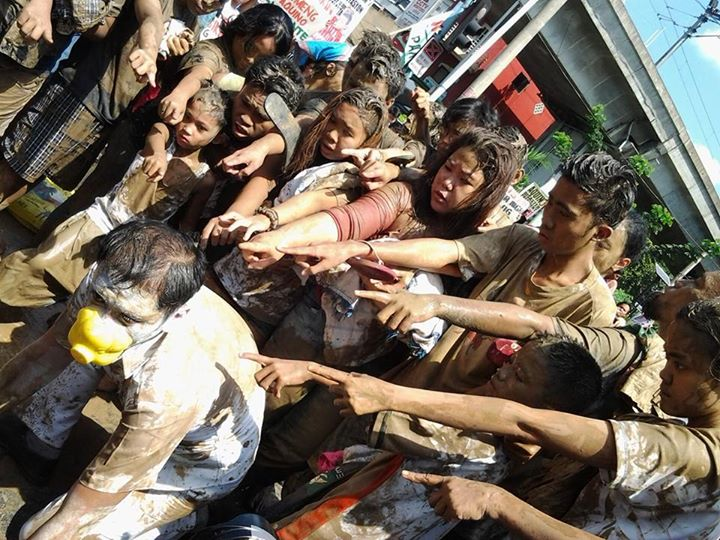 Protesters in Manila covered themselves with mud as part of a nationwide synchronized performance to dramatize the plight of Haiyan victims. Photo Credits: MaiMai Uichanco.