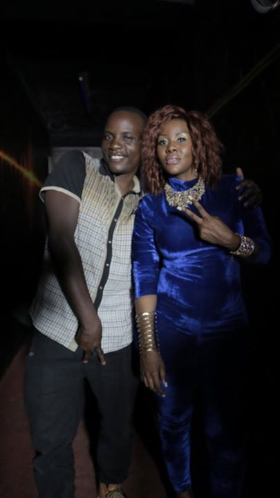 "Frank Jah in a ""Desire pose"" with Desire Luzinda. This photo was widely shared on messaging apps."