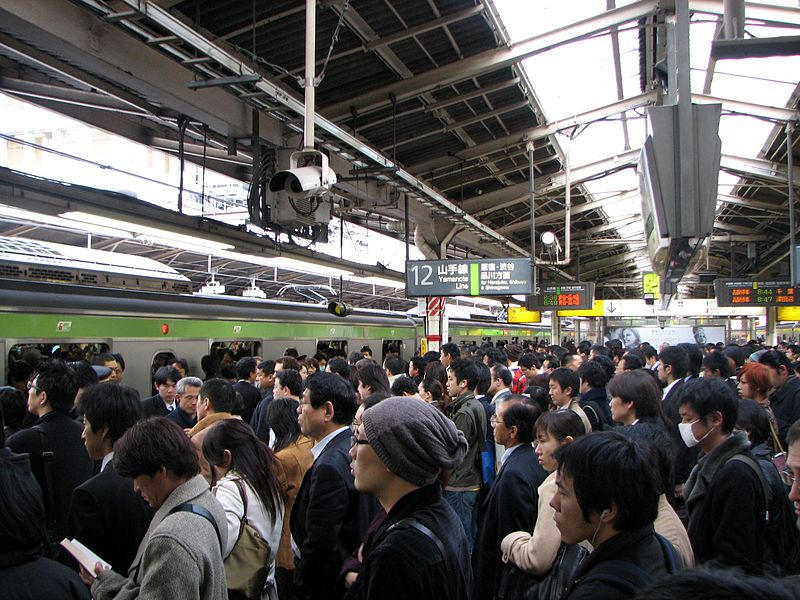 Rush hour in Shinjuku. Image by Chris73. CC BY-SA 3.0 via Wikimedia Commons