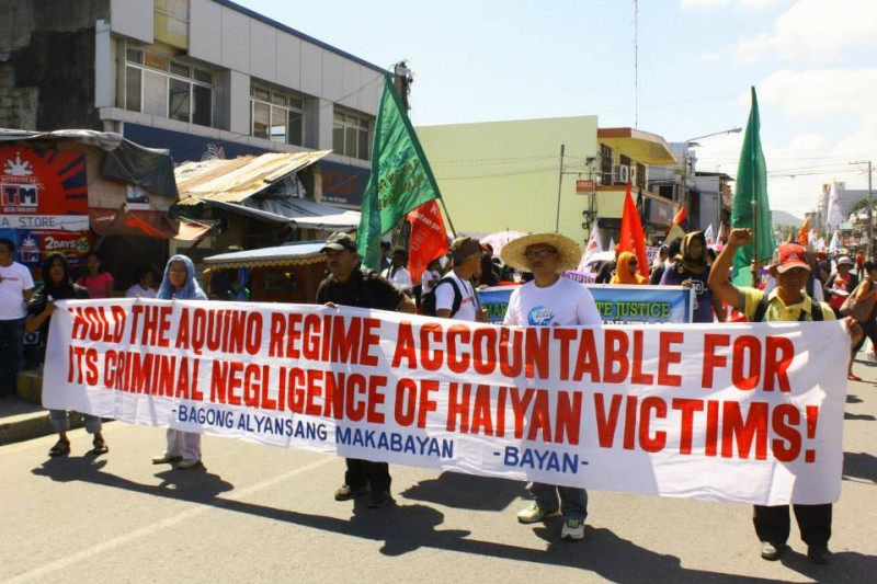 """Global Surge"" protest in Tacloban City during the first year anniversary of super typhoon Haiyan. Photo Credits: Orion Yoshida."