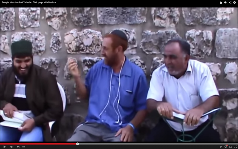 Screenshot of Rabbi Yehuda Glick praying with Muslims (video below). Sourced from YouTube.