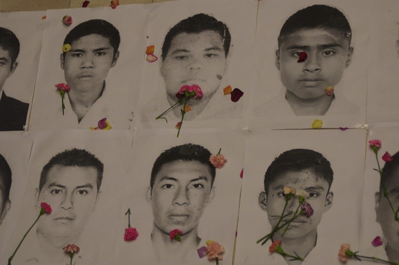 Portraits of missing Mexican students with carnations in a symbolic act in front of the Mexican Embassy in Bogota, Colombia on Nov. 7. Photo from Agencia Prensa Rural's Flickr account. CC BY-NC-ND 2.0